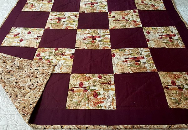 Tuscany squares wine lovers lap quilt with cork back